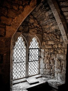 """Beautiful Windows in Ightham Mote, a medieval manor house, dating to around 1320, close to the village of Ightham, near Sevenoaks in Kent. The name """"mote"""" derives from """"moot"""", """"meeting [place]"""", rather than referring to the body of water."""