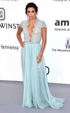 2015 AMFAR GALA: STAR ARRIVALS AT THE CANNES BENEFIT EVA LONGORIA The actress turns heads in an iridescent sky-blue Georges Hobeika Couture gown featuring a sheer, plunging bodice. Tristan Fewings/Getty Images
