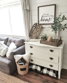 old dresser turned into side table, gingham pillows, rustic tray, plant.