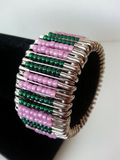 pink and green safety pin bracelet