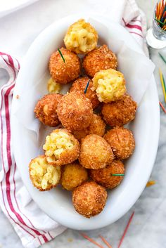 "FRIED MAC & CHEESE BALLS - ""The key to these crispy pasta cheese bombs is creating a crispy exterior to play foil to the creamy center. To get that extra crunchy shell...using Kettle Brand potato chips as the ultimate crunchy coating...because they're thicker and more substantial than other potato chips or bread crumbs, creating just the right crumb coat."""