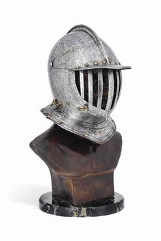 a_north_european_curiassiers_close-helmet_second_quarter_of_the_17th_c_d5699078g.jpg (687×1024)