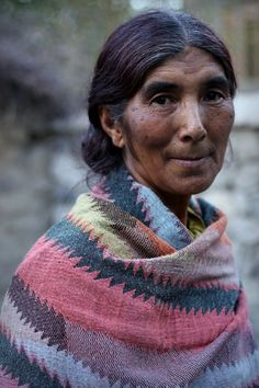 """Ladakhi woman I met on my way smiling to my camera""."