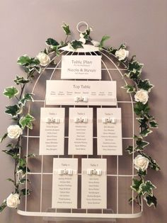 Beautiful birdcage table plan with ivy and roses.