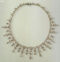 King Khalid Necklace also shares similar provenance with King Faisal Necklace as it was made by Harry Winston as well, in 1978. The Saudi King bought it a year later as a gift for the Queens upcoming official visit. The Queen has since worn it quite often, including for a film première in 1982, visit to France in 2004, and a visit to Malta in 2005.