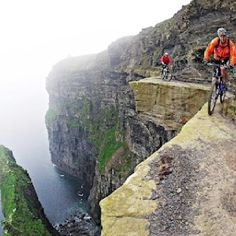 Cycling on 3 foot wide ridge 700 feet above the sea on the Cliffs of Mother, County Clare, Ireland. Photo by Victor Lucas.