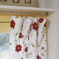 Bargain Curtains  Curtain clips attach the panels (formerly part of a queen-size bed sheet set) to the galvanized-pipe curtain rod.