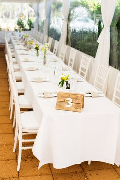 Summer Wedding Tables - White on White with a touch of Yellow. See more on SMP, here: http://www.stylemepretty.com/australia-weddings/western-australia-au/2014/05/27/relaxed-and-stylish-diy-garden-wedding/ Photography: NicolleVersteeg.com