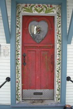 Old Painted Front Door...with a heart shaped window and stenciled trim.