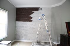 painting faux brick; now white wash it, watered down white paint and a rag to wipe