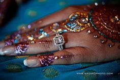 A diamond ring looks even better with glitter henna!