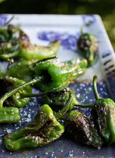 Padròn peppers....hot pan, extra virgin olive oil and good sea salt.  Looks so delicious