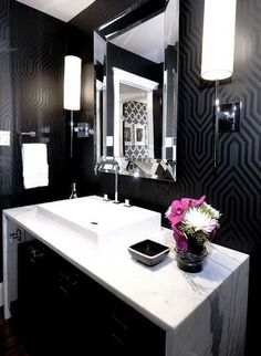 I would love to see this black and marble in a powder room.