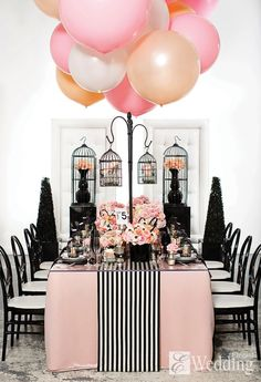 Breast cancer fundraiser focusing on mastectomies. This year the theme would be beauty with scars. The color scheme is light pink and black. Strips polka dots and damask backdrops with being shades of pink to hold balloons.