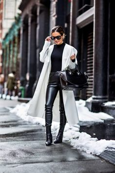 fashion blogger mia mia mine wearing a white trench coat by missguided and black leather pants in soho at nyfw