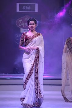 7105ed87e0 White saree with burgundy border and blouse embellished with gold.