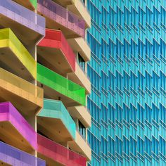 Central Singapore.  Eye-catching balconies.  Really smart use of angles so that everyone gets a view of something other than their neighbours. #architecture #buildings #rainbow