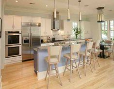 kitchen-with-bamboo-flooring-and-pendant-lamps