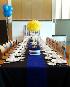 Decoración de mesa en tonos azules y amarillos para una comunión en Castellón realizada por Eventur.