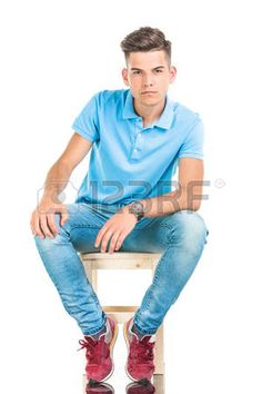 Pensive young man sitting on a chair on isolated background Stock Photo Sitting Pose Reference, Art Reference Poses, Anatomy Reference, Reference Images, Chair Photography, Portrait Photography Poses, Figure Photography, Sitting Poses, Man Sitting