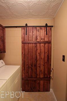 EPBOT: Make Your Own Sliding Barn Door - For Cheap!  Source:  http://www.epbot.com/2013/03/make-your-own-sliding-barn-door-for.html?m=1