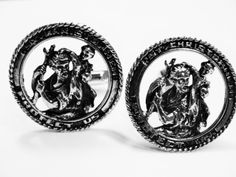 """Here is a pair of sterling silver cuff links with St. Christopher.  The cuff links are patented by Jacob Oldak.  They are approx. 1 1/8"""" across.  The cuff links are in excellent vintage condition.    This item ships free to anywhere in the United States.  I will ship to other countries ~ just contact me for shipping quote."""