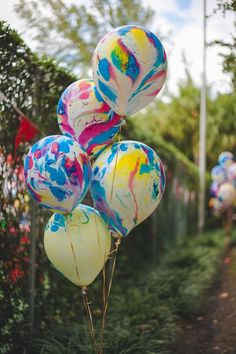 Love these Tie Dye Balloons at a CARNIVAL PARTY via www.KarasPartyIdeas.com