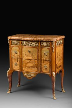 Attributed to Pierre Roussel ,A TRANSITION LOUIS XV - LOUIS XVI ORMOLU-MOUNTED MARQUETRY COMMODE French 18th cent.