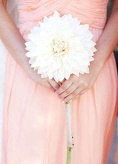 11 Remarkable Single-Flower Wedding Bouquets: Ruffled White Dahlia This oversized flower is an elegant look for any bride's walk down the aisle.
