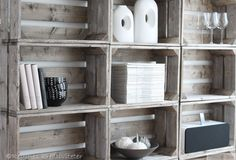 DIY shelving unit from old wooden crates.  Love the feel of the wood.