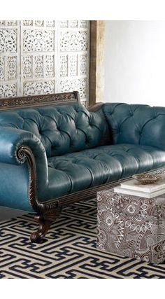 tufted sofa leather~ what a classic looking piece! what a dream it would be to own something like this!