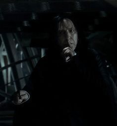Alan Rickman as Professor Severus Snape.