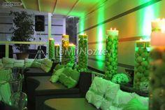 http://www.lemienozze.it/operatori-matrimonio/luoghi_per_il_ricevimento/terrazza-matrimoni-napoli/media/foto/6  Originalissimo allestimento con mele verdi per il ricevimento del matrimonio.