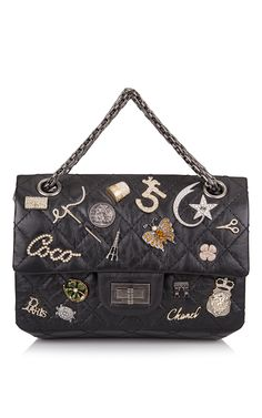 Runway Edition Chanel Black Aged Calfskin Reissue 2.55 Lucky Symbol 224 Flap Bag - Preorder now on Moda Operandi