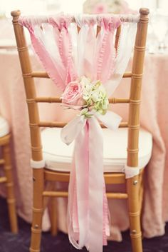 Beautiful pink chair back decorations for a wedding or baby shower // Hostess with the Mostess®