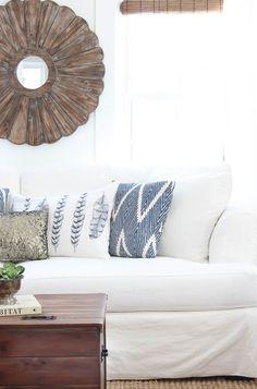 Living Room Refresh - Rooms For Rent blog (wood sunburst mirror, navy, white slipcovered sofa)