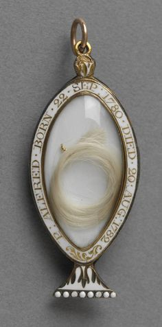 Mourning locket in the form of a funerary urn with seed pearls and amethysts, reverse with lock of hair. Inscribed around edge in gold on white enamel, 'P.ALFRED. BORN 22.SEP 1780 DIED 20 AUG 1782′. Suspension loop. - See more at: http://artofmourning.com/2015/01/19/prince-alfred-funerary-urn-locket/#sthash.1BRJ4hqP.dpuf