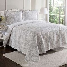"""Refresh your master suite or guest room with this lovely cotton quilt set, showcasing a damask motif in white and neutral hues.  Product: Twin: 1 Standard sham and 1 quiltFull/Queen: 2 Standard shams and 1 quiltKing: 2 King shams and 1 quiltConstruction Material: 100% CottonColor: Neutral and whiteFeatures: Reversible quiltDimensions: Standard Sham: 20"""" x 26""""Twin Quilt: 68"""" x 66""""Full/Queen Quilt: 90"""" x 90""""King Sham: 20"""" x 36""""King Quilt: 98"""" x 106""""Note: Shams do not include insertsCleaning…"""