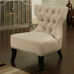 @Overstock - This ivory nailhead chair is upholstered in a comfortable microsuede fabric that is both luxurious and chic. The armless design allows for more versatility and leg room, while saving space to make it perfect for apartments or other small spaces.  http://www.overstock.com/Home-Garden/Abbyson-Living-Sedona-Light-Cream-Microsuede-Nailhead-Chair/6048350/product.html?CID=214117 $267.99