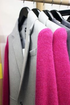 pink knitted sleeves on wool jacket