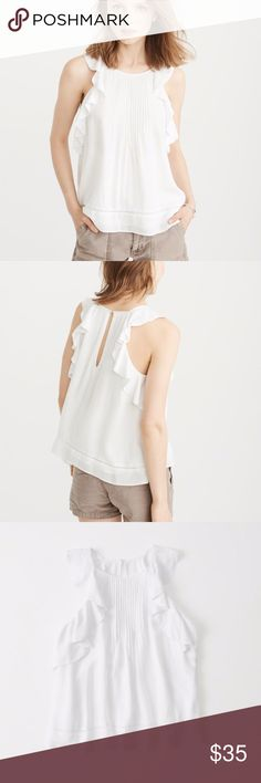 "A&F Ruffle Pintuck Tank Abercrombie & Fitch Brand New With Tags White Ruffle Pintuck Tank Size Medium (A&F Size 8-10, Bust 37-38"")  Textured crewneck tank with ruffle armhole, pintuck detail, keyhole back closure and straight hem. Imported.  Body And Lining:100% Viscose Machine wash cold, with like colors Only non-chlorine bleach Lay flat to dry Low iron if needed Do not dry clean  Orig. Retail Value: $38 Abercrombie & Fitch Tops Tank Tops"