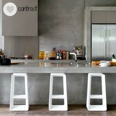 concrete kitchen counters: Kitchen islands are great in that they encourage interaction between both sides; whoever is working in the kitchen and guests or family members. They also provide a place for informal dining and for the kids to do their homework, so choosing the right bar stools is important. Height, comfort and aesthetics all come in to play, depending on what your preferences are.