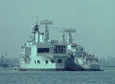 Hms Blake ASW Cruiser with a HMS Kent a batch 1 County Class Guided Missile Destroyer on her starboard side.