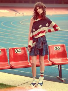 Antonina Petkovic channels her inner sports star for the March 2016 issue of Vogue Brazil. Posing in a stadium setting, the Serbian model hits the race track in red, white and blue fashions with athletic vibes. Photographed by Henrique Gendre and styled by Luis Fiod, the brunette wears everything from striped sweaters to distressed denim …