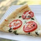 Four Cheese Margherita Pizza - this would be awesome with goat cheese, mozzarella, Gorgonzola, Parmesan, and feta. Mmmmm