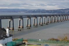 The Tay Bridge (sometimes unofficially the Tay Rail Bridge) is a railway bridge approximately 2.75 miles (3.5 kilometres) long[1] that spans the Firth of Tay in Scotland, between the city of Dundee and the suburb of Wormit in Fife (grid reference NO391277). As with the Forth Bridge, the Tay Bridge has also been called the Tay Rail Bridge since the construction of a road bridge over the firth, the Tay Road Bridge. The rail bridge replaced an early train ferry.