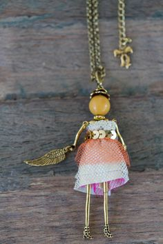 A fun French doll pendant necklace named Genevieve | https://www.etsy.com/listing/218178103/genevieve-a-french-doll-pendant-necklace?ref=shop_home_active_3