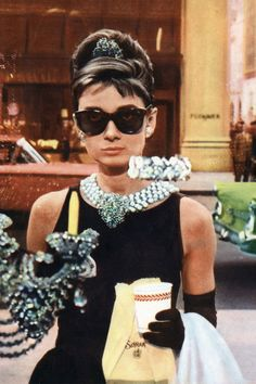 LBD + Statement Necklace + Black Sunnies + Chignon = Holly Golightly   - HarpersBAZAAR.com