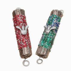 This special (indoor) mezuzah is made from weaving strips of recycled soda cans with metal. Available in green/blue/white (Sprite), red/white/black (Coca Cola), and black/white/red (Coca Cola Zero).