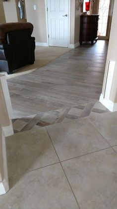 Mosaic tile as transition good way to use broken pieces for Flooring transition from kitchen to family room